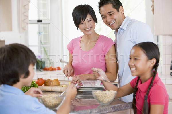 Family In Kitchen Eating Breakfast Stock photo © monkey_business