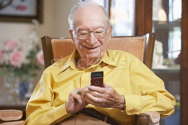 Idős férfi sms üzenetküldés szemüveg idős személy Stock fotó © monkey_business