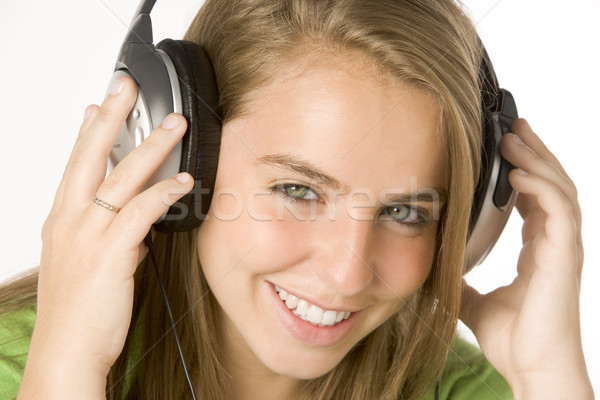 Ouvir música fones de ouvido feliz cor adolescente Foto stock © monkey_business
