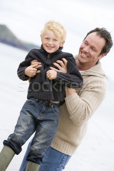 ストックフォト: 父 · ビーチ · 笑みを浮かべて · 子
