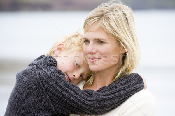 Mother holding son at beach smiling Stock photo © monkey_business
