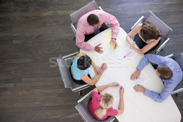 Stock photo: Five businesspeople at boardroom table