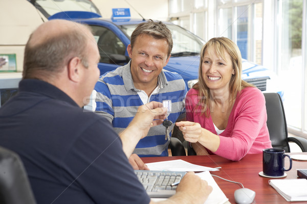 Couple filling in paperwork in car showroom Stock photo © monkey_business