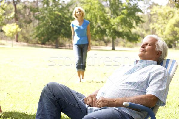 Idős férfi megnyugtató park feleség boldog Stock fotó © monkey_business
