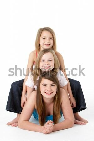 Three Girls laying On Stomach In Studio Stock photo © monkey_business