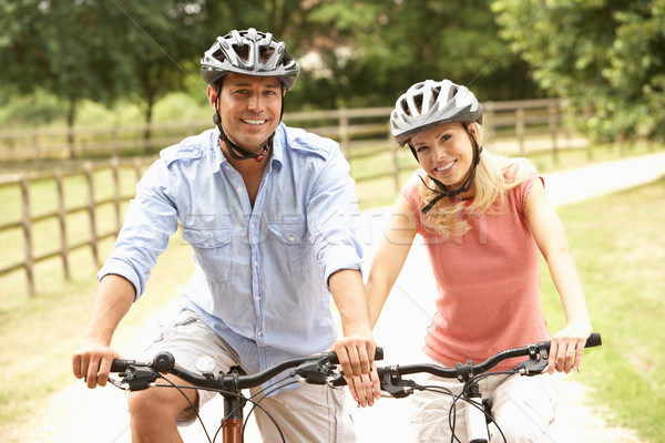 Casal ciclismo segurança capacetes Foto stock © monkey_business