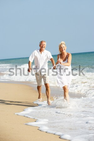Senior Couple Enjoying Beach Holiday Stock photo © monkey_business