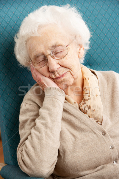Senior Woman Resting In Chair At Home Stock photo © monkey_business