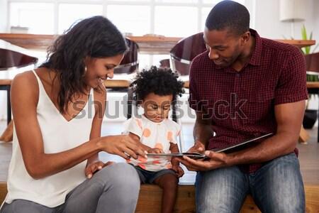 Hispanic family shopping online Stock photo © monkey_business