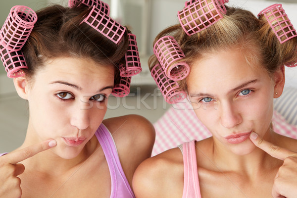 Teenage girls with hair in curlers Stock photo © monkey_business