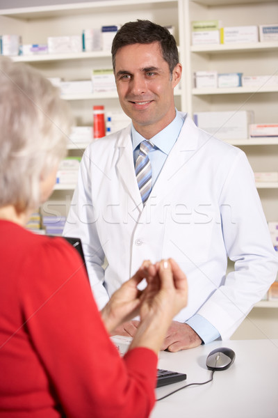 American pharmacist with senior woman in pharmacy Stock photo © monkey_business