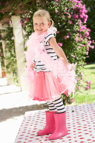 Young Girl Wearing Pink Wellington And Feather Boa Stock photo © monkey_business