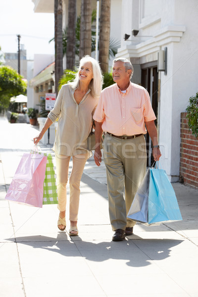 Senior Couple Carrying Shopping Bags Stock photo © monkey_business