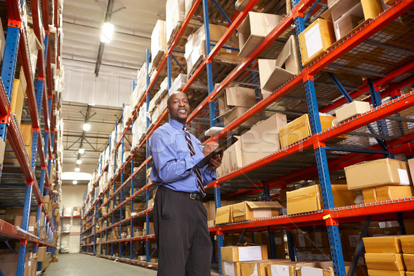 Businessman With Clipboard In Warehouse Stock photo © monkey_business