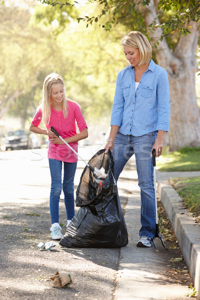 Mother And Daughter Picking Up Litter In Suburban Street Stock photo © monkey_business