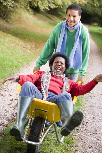 Son pushing mother in wheelbarrow Stock photo © monkey_business