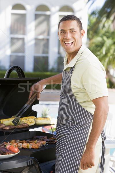Man Barbequing In A Garden Stock photo © monkey_business