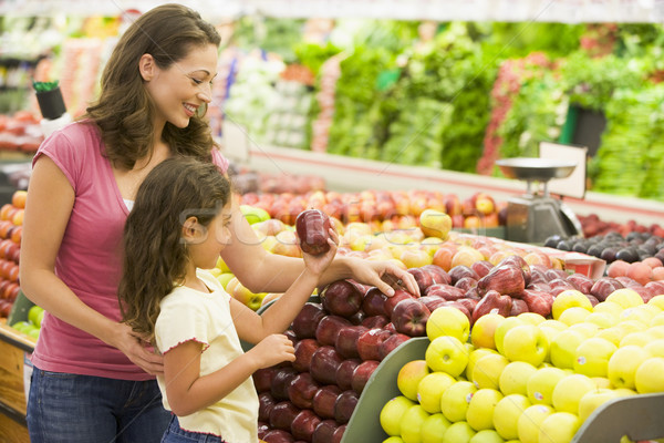 Mother and daughter shopping for fresh produce Stock photo © monkey_business