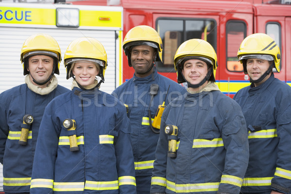 Portrait of a group of firefighters by a fire engine Stock photo © monkey_business