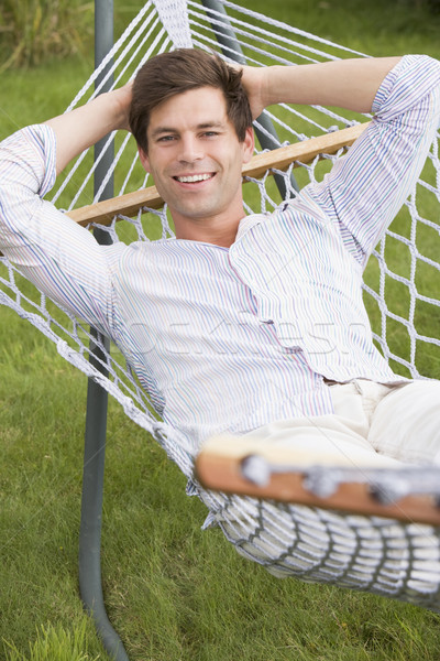 Man relaxing in hammock smiling Stock photo © monkey_business