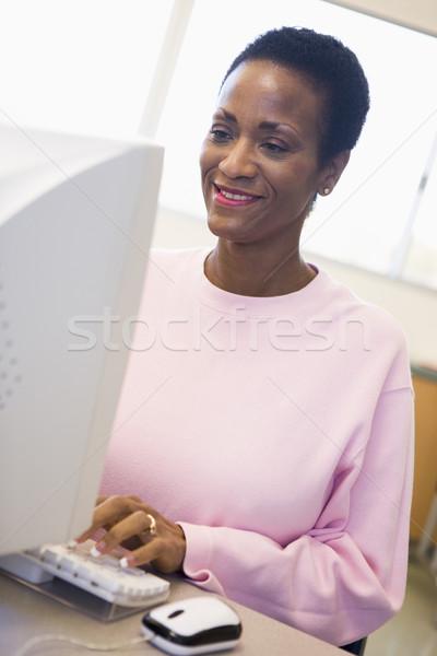 Mature female student learning computer skills Stock photo © monkey_business