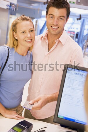A teacher talks to a schoolgirl using a computer in a high schoo Stock photo © monkey_business