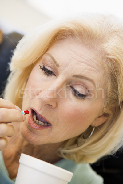Woman Swallowing Pill Stock photo © monkey_business