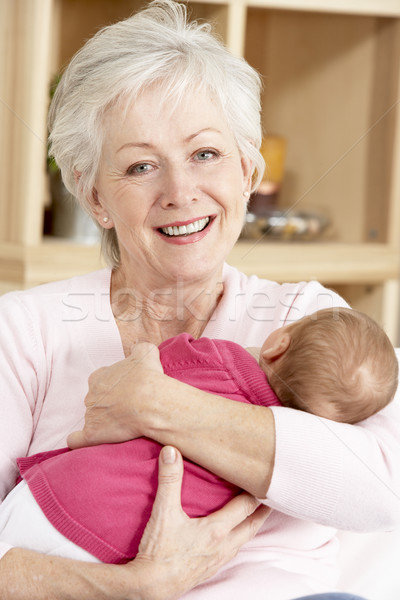 Grandmother Cuddling Granddaughter At Home Stock photo © monkey_business