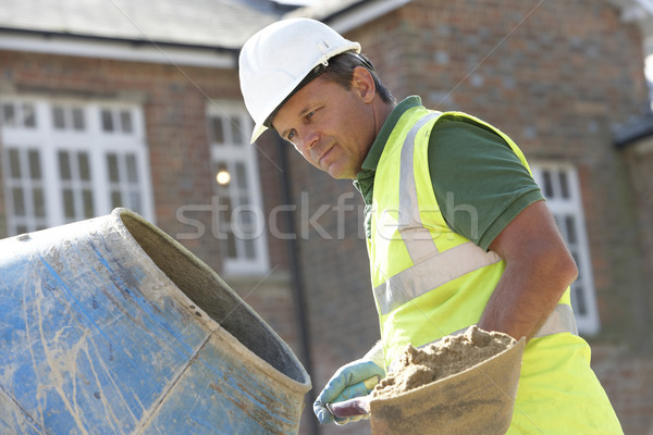 Stock photo: Construction Worker Mixing Cement