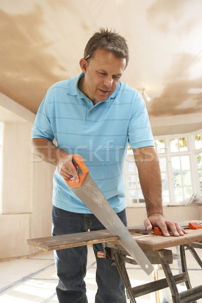 Builder Sawing Wood On Workbench Stock photo © monkey_business