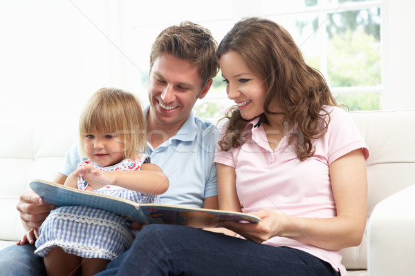 Family Sitting On Sofa Reading Book At Home Stock photo © monkey_business