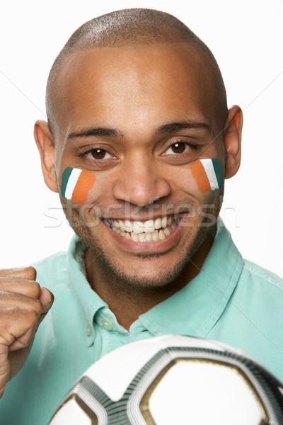 Fiatal férfi futball ventillátor Elefántcsontpart zászló Stock fotó © monkey_business