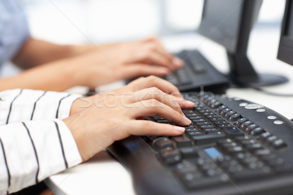 Close up businesswomen typing Stock photo © monkey_business