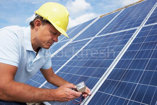 Stock photo: Man installing solar panels