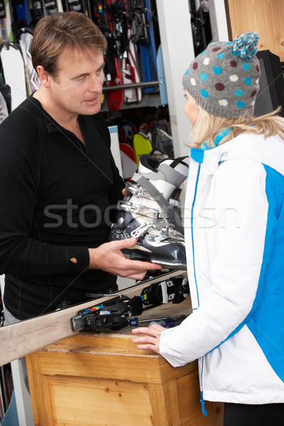 Sales Assistant Helping Advising Female Customer On Ski Boots In Stock photo © monkey_business