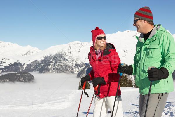 Casal esquiar férias montanhas homem Foto stock © monkey_business