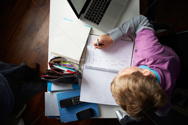 Overhead View Of Boy Studying In Bedroom Stock photo © monkey_business