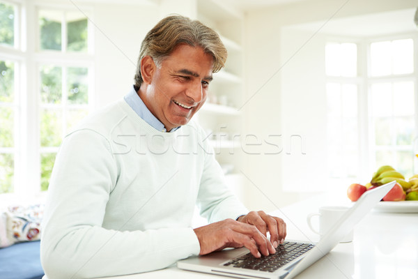 Senior Indian Man Using Laptop At Home Stock photo © monkey_business