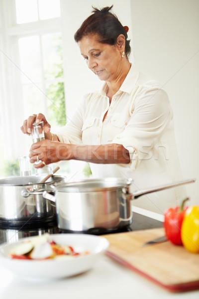 Idős indiai nő főzés étel otthon Stock fotó © monkey_business