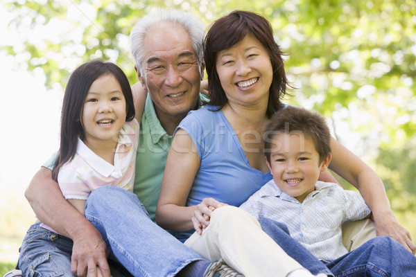 Grands-parents rire petits enfants famille fille heureux Photo stock © monkey_business
