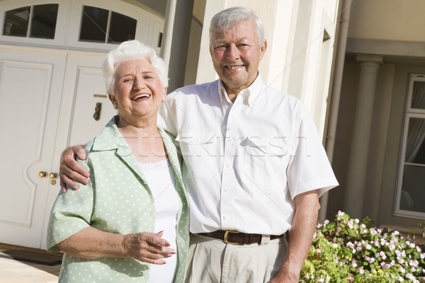 Senior couple standing outside house Stock photo © monkey_business