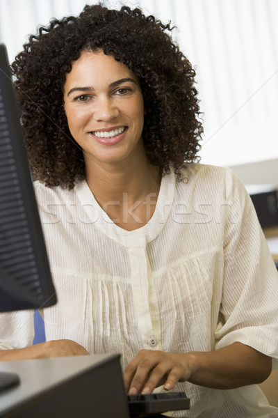 Stock photo: Mid adult woman working on a computer