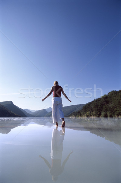 Young woman wading in lake Stock photo © monkey_business