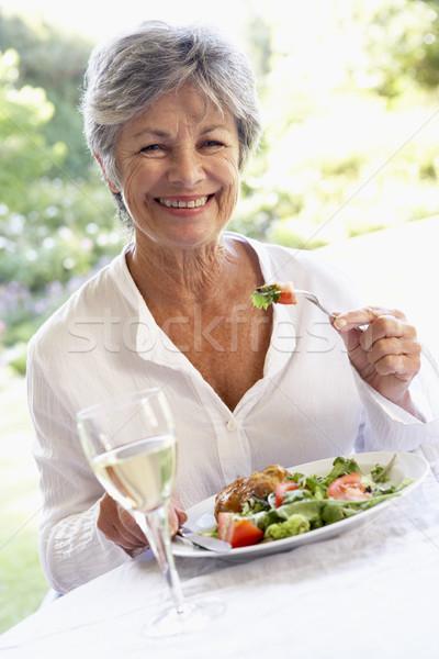Senior Woman Eating An Al Fresco Lunch Stock photo © monkey_business