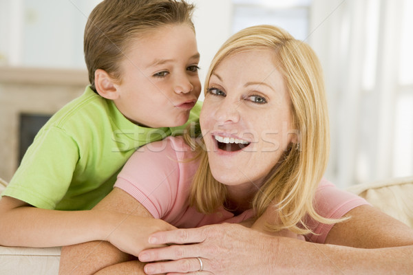 Young boy kissing smiling woman in living room Stock photo © monkey_business