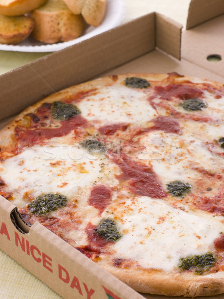 Cheese, Tomato And Pesto Pizza In A Take Away Box With Garlic Br Stock photo © monkey_business