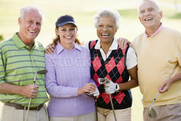 Portrait Of Four Friends Enjoying A Game Golf Stock photo © monkey_business