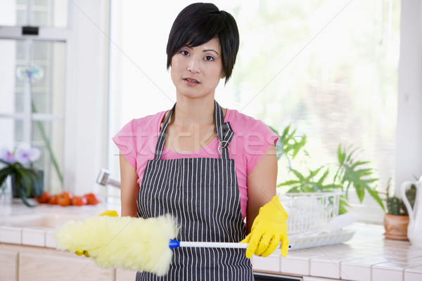 Woman Holding Duster And Wearing Rubber Gloves Not Looking Impre Stock photo © monkey_business