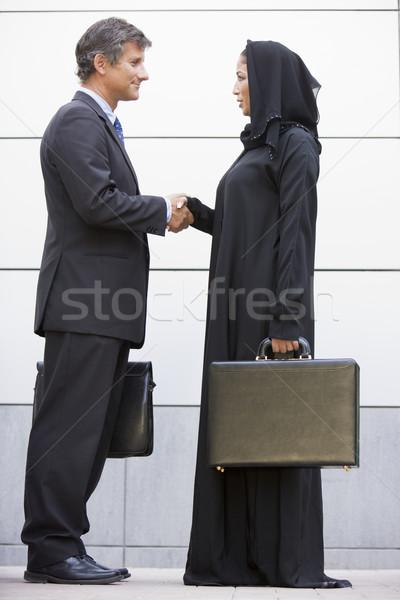 Stock fotó: Közel-keleti · üzletasszony · kézfogás · kaukázusi · iroda · férfi