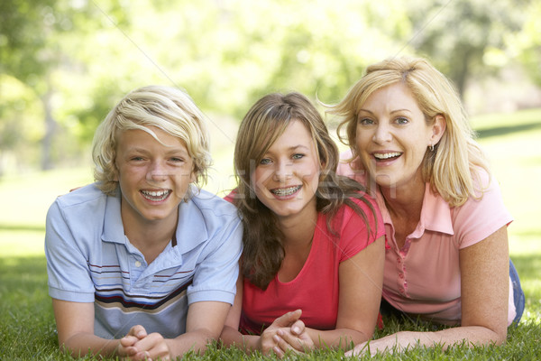 Woman And Her Teenage Children Lying On Grass Stock photo © monkey_business